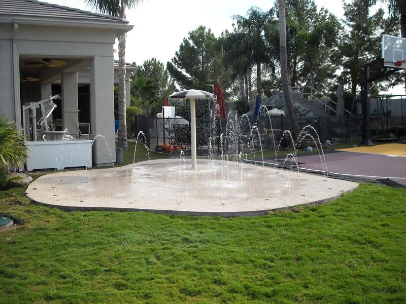 A backyard splash pad from New Image