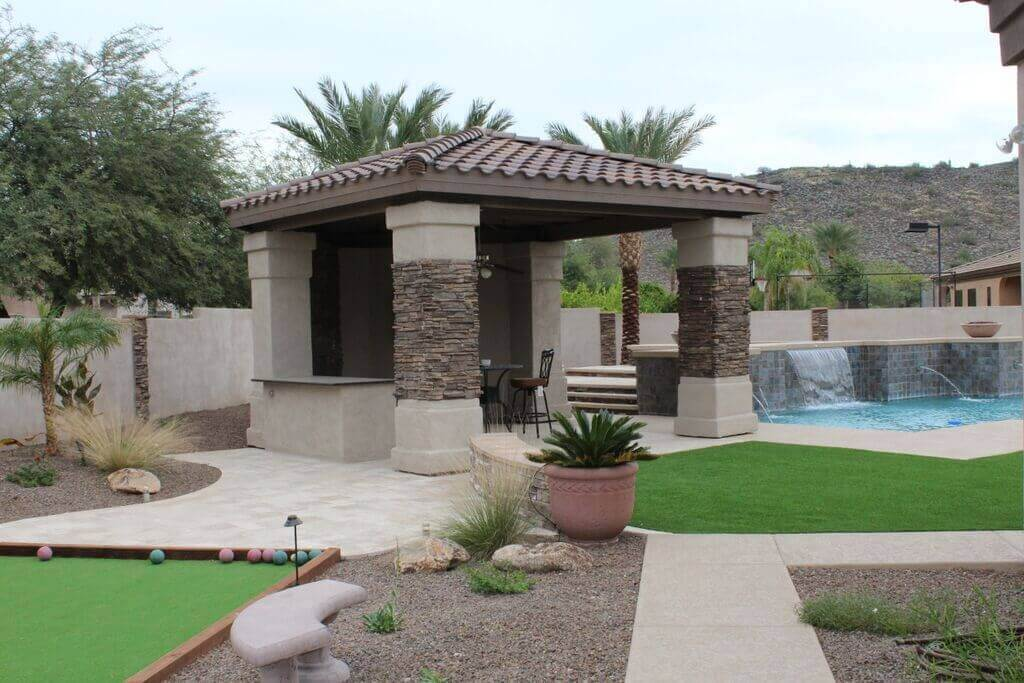 A gigantic Arizona pergola built right next to this family's lovely pool.
