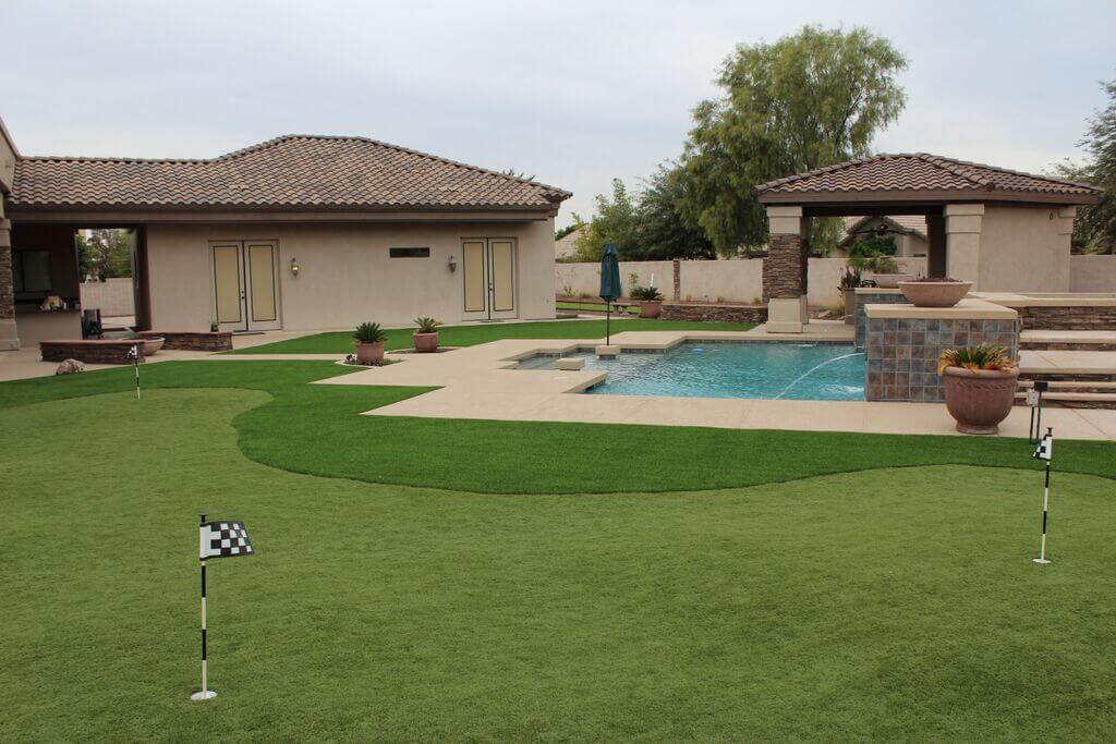 Backyard pool with synthetic turf putting field and large pergola, all designed with 3D landscape models