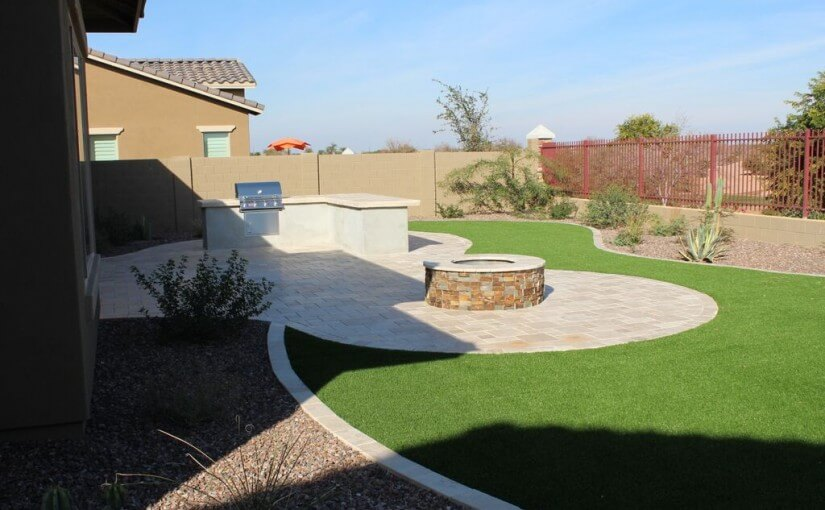 Cleanly-laid synthetic turf surrounding grill and fire-pit by New Image, Phoenix's leading provider of synthetic turf resources in Scottsdale