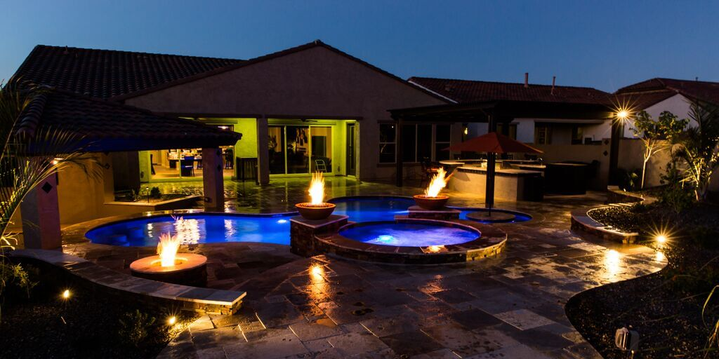 Luxurious backyard pool and spa with fire features, another beautiful Mesa landscape built by New Image