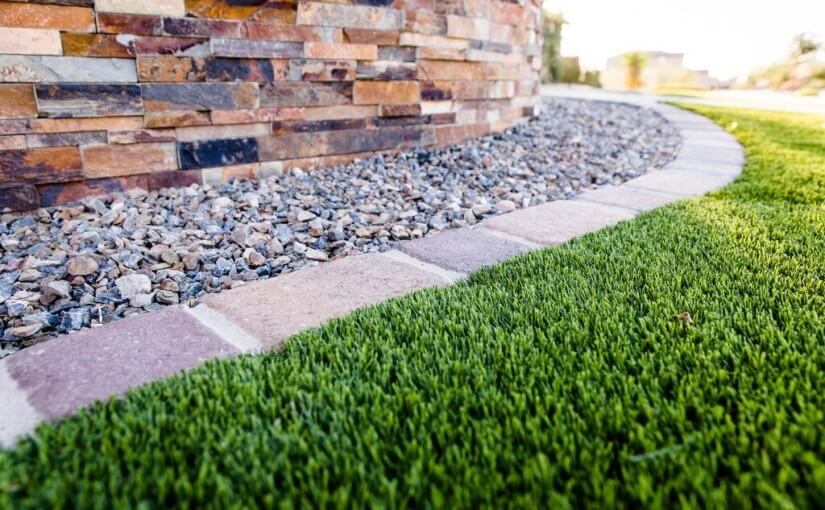 Synthetic lawn edged with bricks and rocks by New Image, Phoenix's leading provider of synthetic turf solutions. Scottsdale