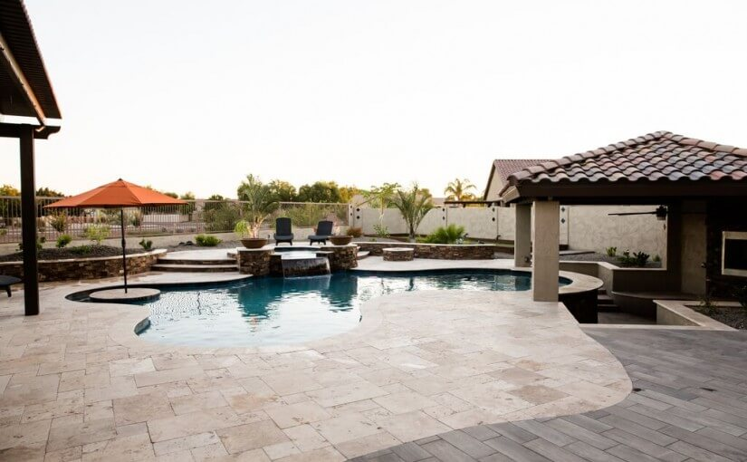 Fenced in pool and spa with umbrella built by New Image, experts in landscaping Scottsdale & Gilbert, AZ