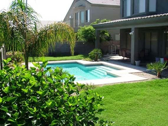 Beautifully landscaped backyard with crystal clear pool water by New Image, finest of Mesa's landscaping companies