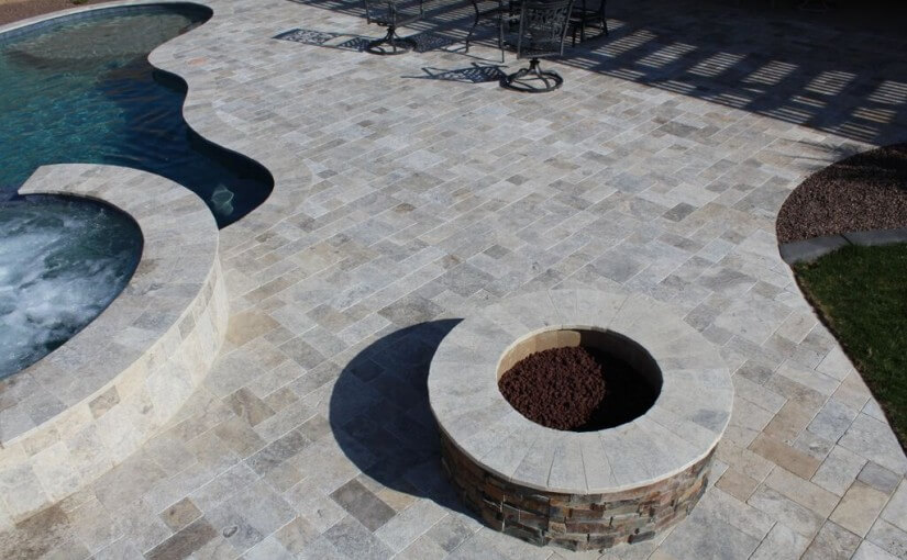 Aerial View of elevated multicolored fire pit accompanying pool and spa by New Image, Mesa & Scottsdale landscaping company