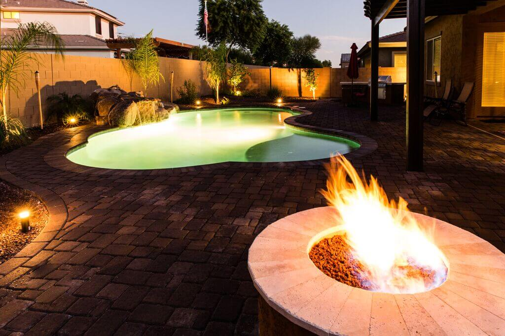 Built in outdoor fireplaces offer a cozy spot on chilly nights