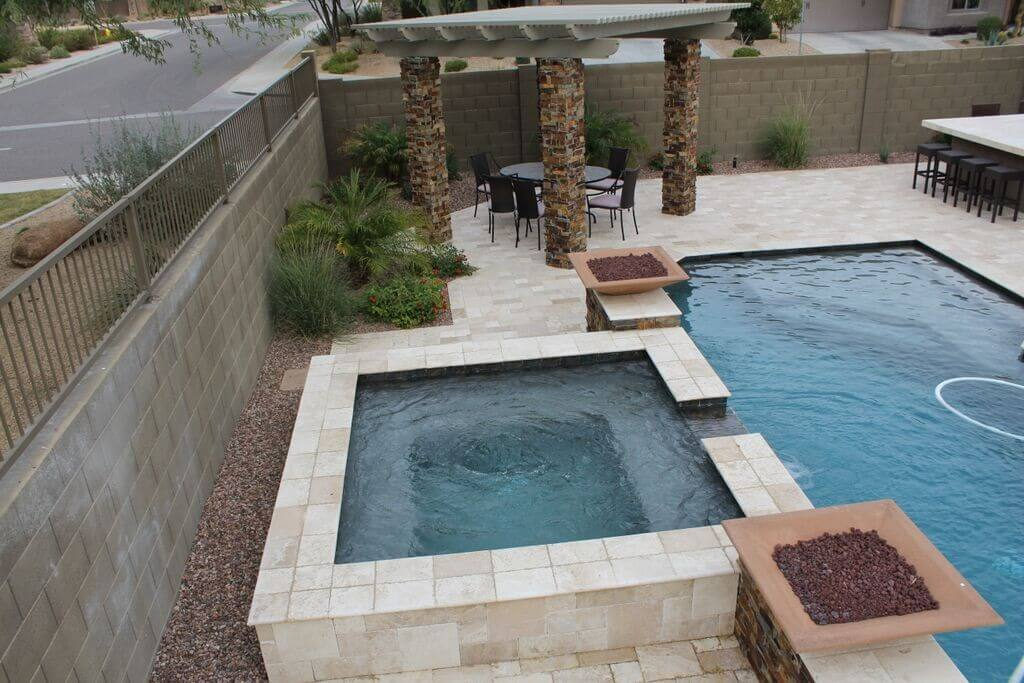 Beautifully finished pool and spa with textured stone pergola by New Image's Mesa pool service