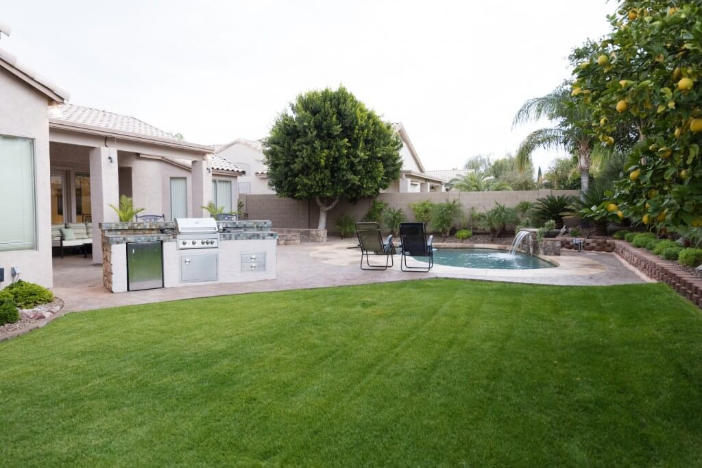 Beautifully laid synthetic turf accompanying nearby pool by New Image, the best landscapers in Mesa, AZ