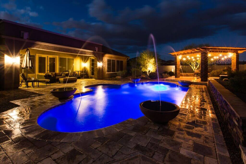 Marvelous pool with four water features and brightly lit pergola by New Image's Mesa pool service