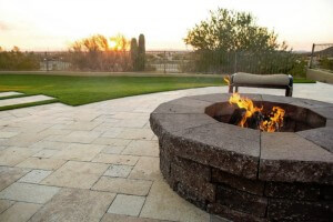 Close-up of fire feature overlooking synthetic field by New Image, the best landscapers in Mesa, AZ