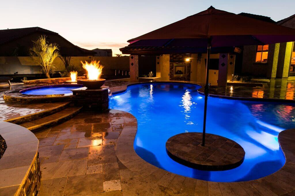Luxurious lit pool with fire features by New Image, finest of Mesa's landscaping companies