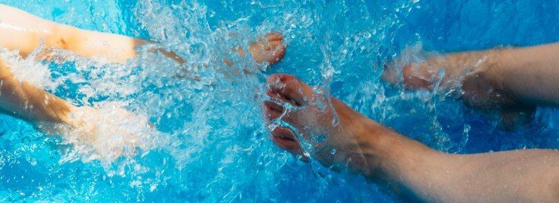 feet splashing in an Arizona swimming pool